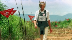 Diana, Princess of Wales, walks in one of the safety corridors of the land mine field of Huambo, January 15. Diana is on a four-day visit to Angola to help a Red Cross campaign to outlaw landmines worldwide. - RTXHQMJ